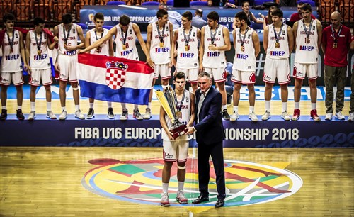 FIBA Executive Director Europe Kamil Novak presents Croatia captain Matej Bosnjak wih the trophy