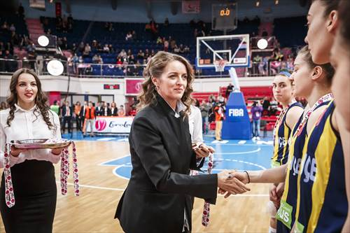 FIBA Europe Women's Commission Member Ms Irina Sumnikova presents Fenerbahce with the silver medals