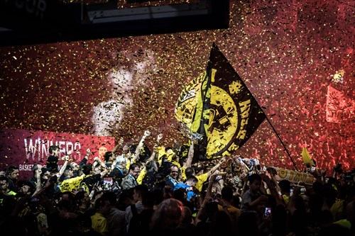 Fans and team of AEK celebrating