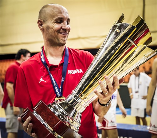 Croatia head coach Milan Karakas with the championship trophy