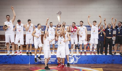 Champions Malta lift the trophy