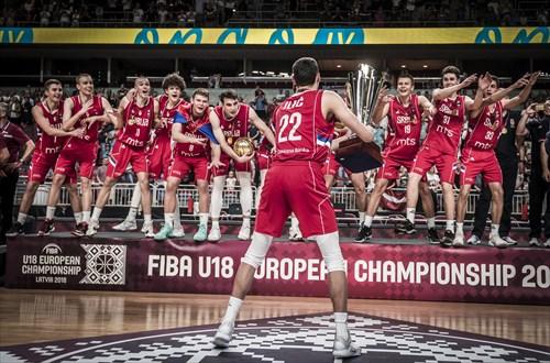 Serbia captain Dalibor Ilic lifts the trophy
