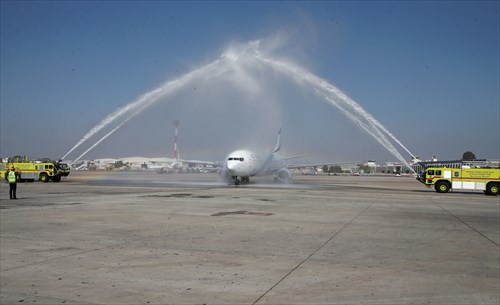 The plane carrying the champions received a water salute upon touching down in Israel