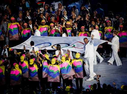 Oscar Schmidt carrying the Olympic flag