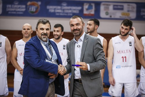 FIBA Crew Chief Commissioner Sergio Borroni presents Damiano Battistini, President of the San Marino Basketball Federation with the organizers' award