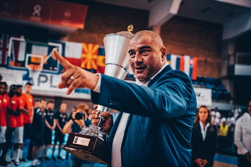 Romania Basketball Federation President Horia Paun with the champion's trophy